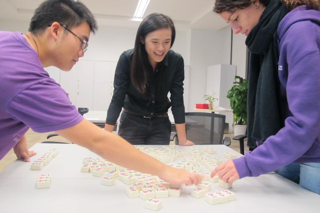 This Single's Day, faculty, staff and students practiced their skills and their mandarin by playing Mahjong, a Chinese game that dates back to the Ming era when it was invented supposedly by Admiral Zheng He 's ship crew to liven up their long sea voyages.