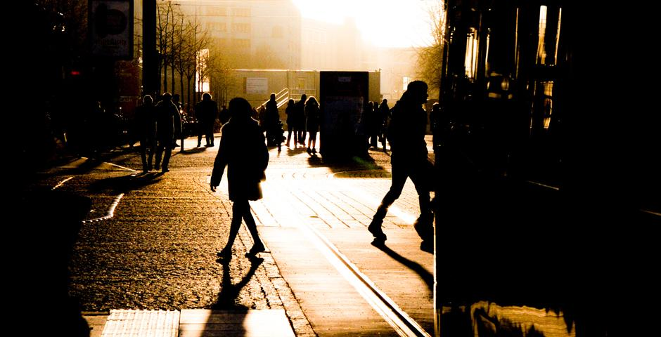 By Guillermo Carrasquero (Berlin)    Photo of the trance inducing afternoon sun of Berlin, the city of adventures and human transparency. This picture shows not only the beautiful afternoon but the pacing and feel of the city as we see the citizens of these streets walking in all directions, while not missing the classic Berlin tram.