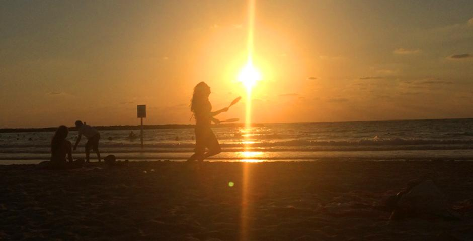 By Julie Hauge (Tel Aviv)  Playing Matkot as the sun sets on the beaches in Tel Aviv. Matkot is a very popular paddle game in Israel, usually played on the beach and often gets quite competitive.