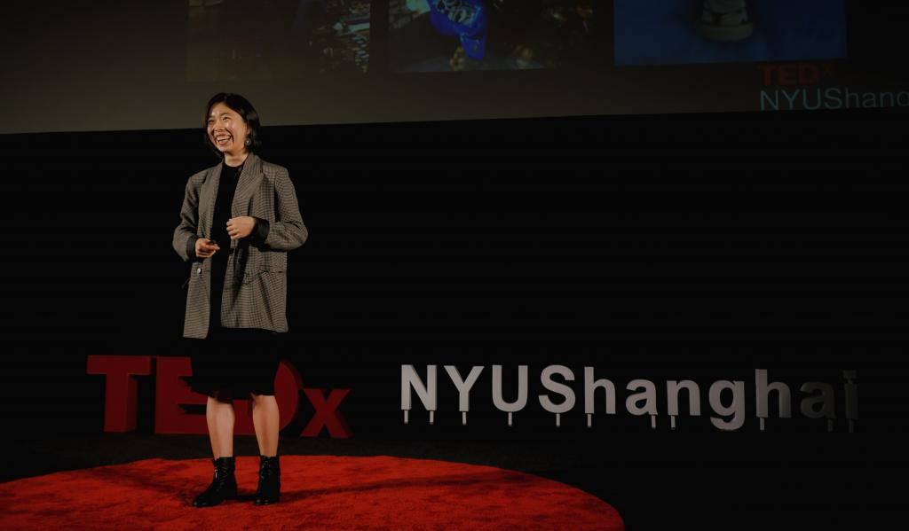 """Wildlife conservation activist Zoe Huang shared a humorous moment onstage with listeners. Huang has worked closely with major Chinese companies operating in Africa to deliver wildlife conservation education to over 160,000 Chinese workers on the continent. """"If China is a problem [in illegal wildlife trade], China should also be the solution,"""" Huang told the audience.NYU Shanghai Assistant Professor of Urban Science and Policy Guan Chenghe showed the TEDxNYUShanghai audience how allowing other ac"""