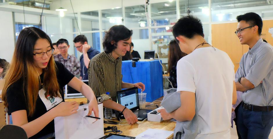 """The end-of-semester Interactive Media Arts Show on May 19 saw students present creations from a huge span of courses including """"The Nature of Code,""""  """"Exploring Sonic Environments,"""" and """"Animation."""" (Photos by: NYU Shanghai)"""