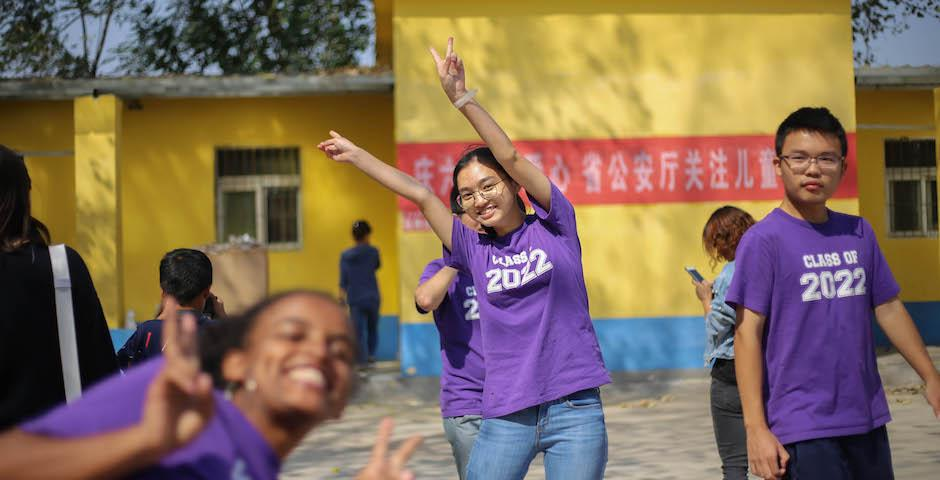 The positivity and hospitality of local villagers deeply impressed the NYU Shanghai students. Madher Teshome '22 (left) and Chen Mingming '22 (middle) played games with school pupils outdoors during the break. (Photo by Takumi Miyawaki, NYU AD '20)
