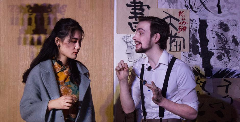 Lauren Benedict '21 directed a cast of 14. In this scene, Victor, played by Ethan Slater '22, explains to his girlfriend Mei, played by Ouyang Yifan '22, the significance of a necklace to the murder mystery. [Photo by Kyle Maloney '21]