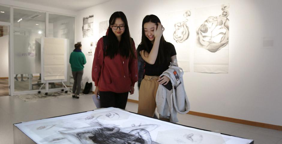 On December 6, students, faculty, and staff gathered at Art in Translation — an exhibition of works by students in Professor Barbara Edelstein and Professor Jian-Jun Zhang's Projects in Studio Art and Introduction to Studio Art classes. Students presented contemporary experimental works in calligraphy, ink, and multimedia using traditional Chinese and other art methodologies.