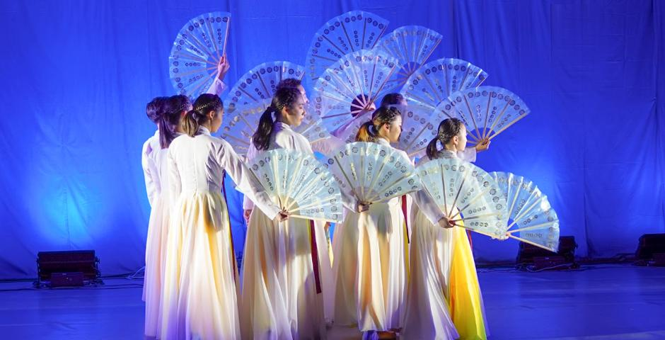 """As the semester came to a close, NYU Shanghai's classrooms, hallways and performance spaces  were filled with students dancing in costume, playing instruments, displaying paintings and photographs, and pitching business ideas as they completed and shared their final course projects. Pictured: Students performing a Korean fan dance titled, """"Cranes"""" at the Fall Dance Concert, Heavenly Bodies, on December 8."""