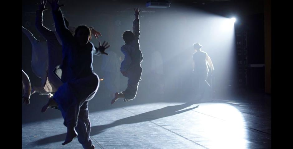 """Students caught mid-air during """"On The Border,"""" at the Fall Dance Concert. The show included performances from Ballet, Contemporary, Chinese Minority & Folk, and Choreography & Performance classes with invited guest performances by the NYUSH Chamber Ensemble and Piano."""