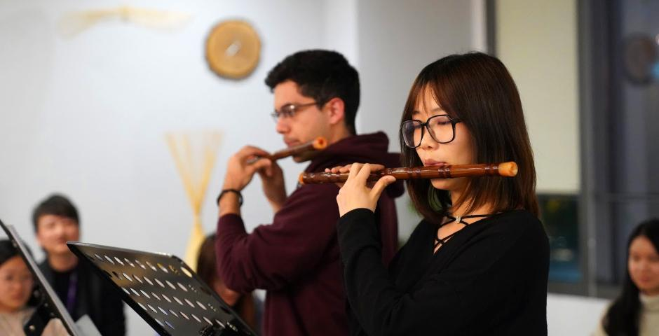 """Tony Carapia Valle '21 and Zeping Fei '20 played a duet of """"My Heart Still"""" during the Bamboo Flute class final performance held in the World Languages Lounge on December 10."""