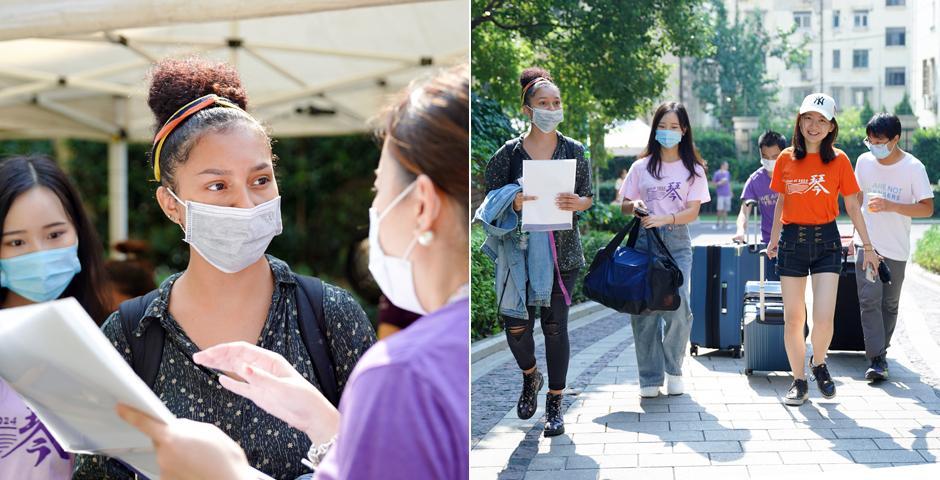 """来自美国的新生Teresa Angulo已在中国生活了十年,父母均在江苏无锡工作。""""我想和世界各地的人交朋友,""""她说,""""上海纽约大学文化多元、活力四射,这点我非常喜欢。""""图为2023届迎新大使郭芷青和冯泊宁帮Angulo搬行李。"""