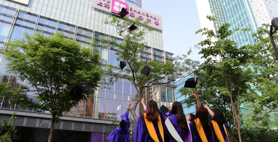 Master's graduates of the NYU Shanghai Class of 2020 gather on Century Avenue to toss their caps and celebrate the moment.