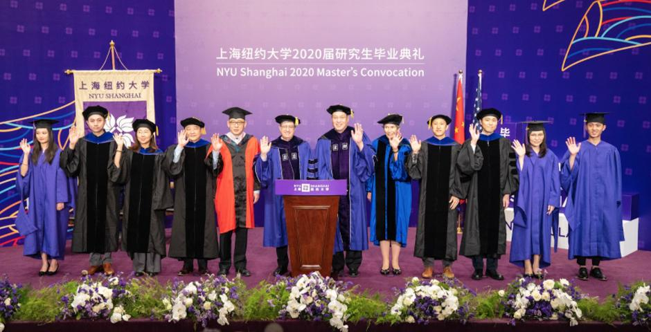 The platform party included NYU Shanghai leadership, faculty representatives, and student representatives.