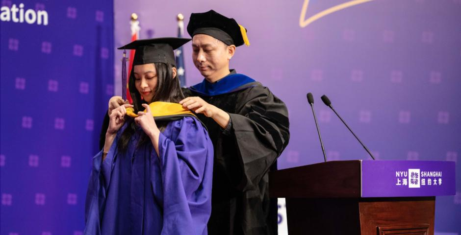 Professor Ming Liao hooded Chen Yijie, MS '20, on behalf of all Data Analytics and Business Computing Program graduates.