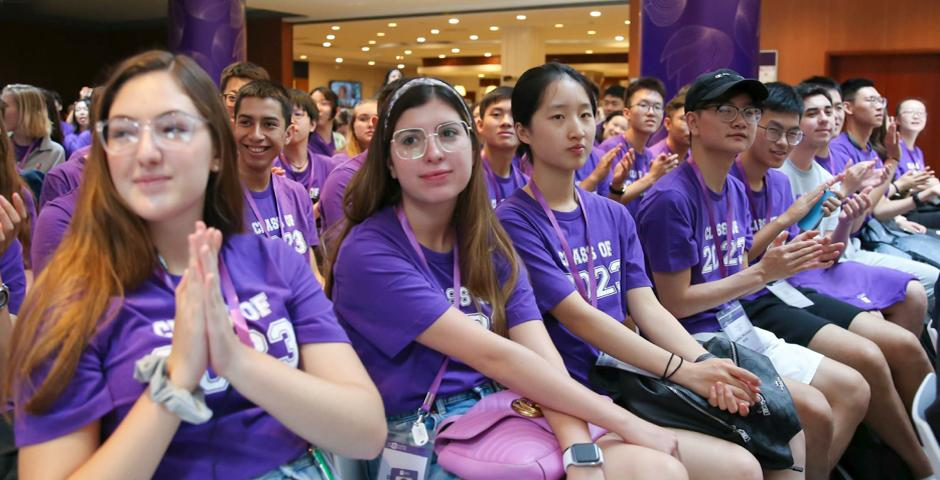 """A sea of violet-clad first years settle in for welcome remarks presented by Chancellor Yu Lizhong, Vice Chancellor Jeff Lehman, and Provost Joanna Waley-Cohen at the August 26 University Welcome. """"Communities don't just come into being – you have to work on them. They take time and effort to construct,"""" Waley-Cohen said in her address."""