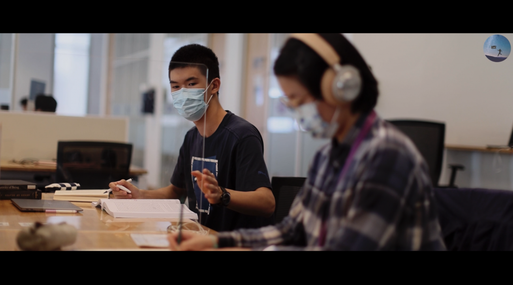 """The Note: Zhang Yutan '24 says she and her teammates initially struggled with conflicting ideas about their assigned object, a mask, until the connection theme showed them the way forward. """"All of our previous thoughts were about connection, and since wearing masks makes it harder to talk face-to-face, we began to think about other methods of communication,"""" Zhang said. Her team's film ultimately tells the story of two students who stumble into friendship through a book."""