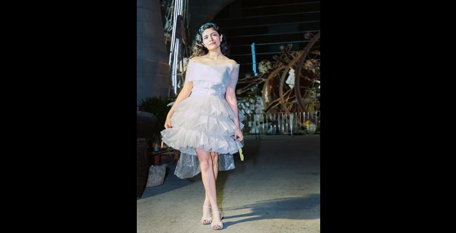 """Daisy Bugarin '21 walked the runway in """"A Plastic Predicament,"""" designed by Diana Yu '22 from  bubble wrap. Yu said she designed the dress to remind the audience of the high volume of plastic that is consumed by humans every day."""