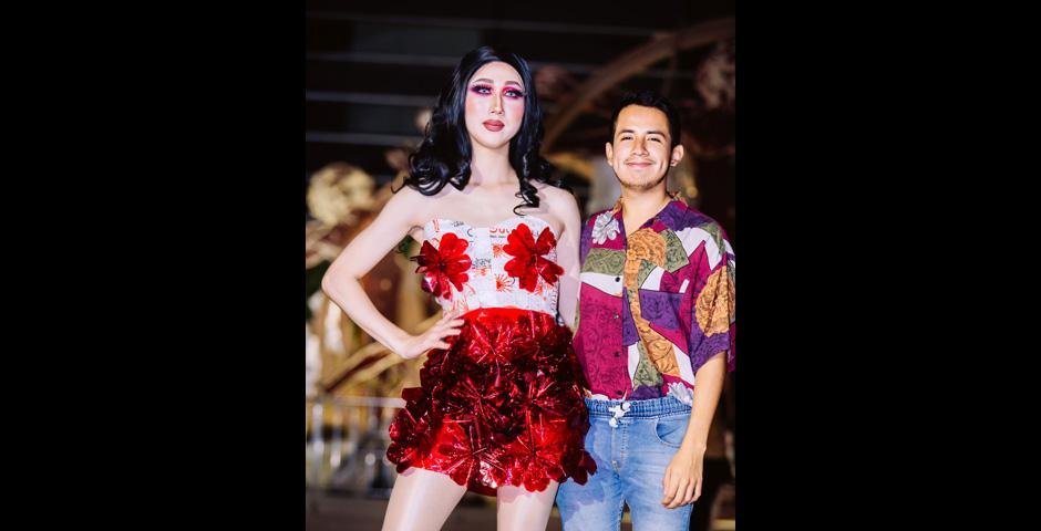 """Salomon Ruiz '21 cut and braided compressed plastic bags and bubble wrap to create """"Rouge Comme La Fleur,"""" modeled by Eric Shin '20. Both the skirt and flower decorations are made out of paper."""